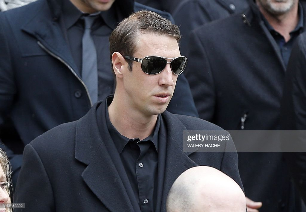 French swimmer <a gi-track='captionPersonalityLinkClicked' href=/galleries/search?phrase=Alain+Bernard+-+Swimmer&family=editorial&specificpeople=775873 ng-click='$event.stopPropagation()'>Alain Bernard</a> leaves after attending the funeral ceremony of late French swimmer and Olympic champion Camille Muffat, on march 25, 2015 in Nice, southeastern France. Camille Muffat was among 10 people killed in a helicopter crash in Argentina ten days ago. AFP PHOTO / VALERY HACHE