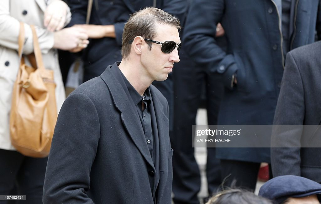 French swimmer <a gi-track='captionPersonalityLinkClicked' href=/galleries/search?phrase=Alain+Bernard+-+Swimmer&family=editorial&specificpeople=775873 ng-click='$event.stopPropagation()'>Alain Bernard</a> leaves after attending the funeral ceremony of late French swimmer and Olympic champion Camille Muffat, on march 25, 2015 in Nice, southeastern France. Camille Muffat was among 10 people killed in a helicopter crash in Argentina ten days ago.