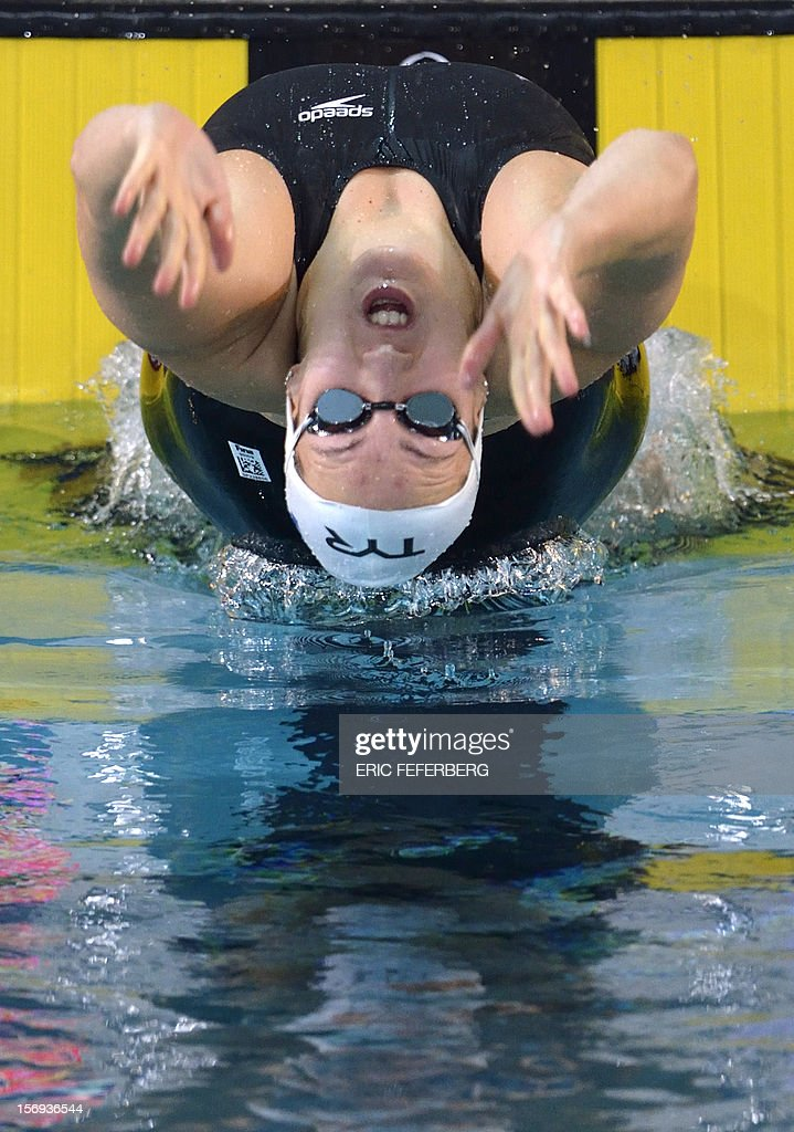 French swimmer Alexianne Castel leaps at the start of the women's 200m backstroke final at the European short course Swimming Championships on November 25, 2012, in Chartres. Castel came in second in the competition.