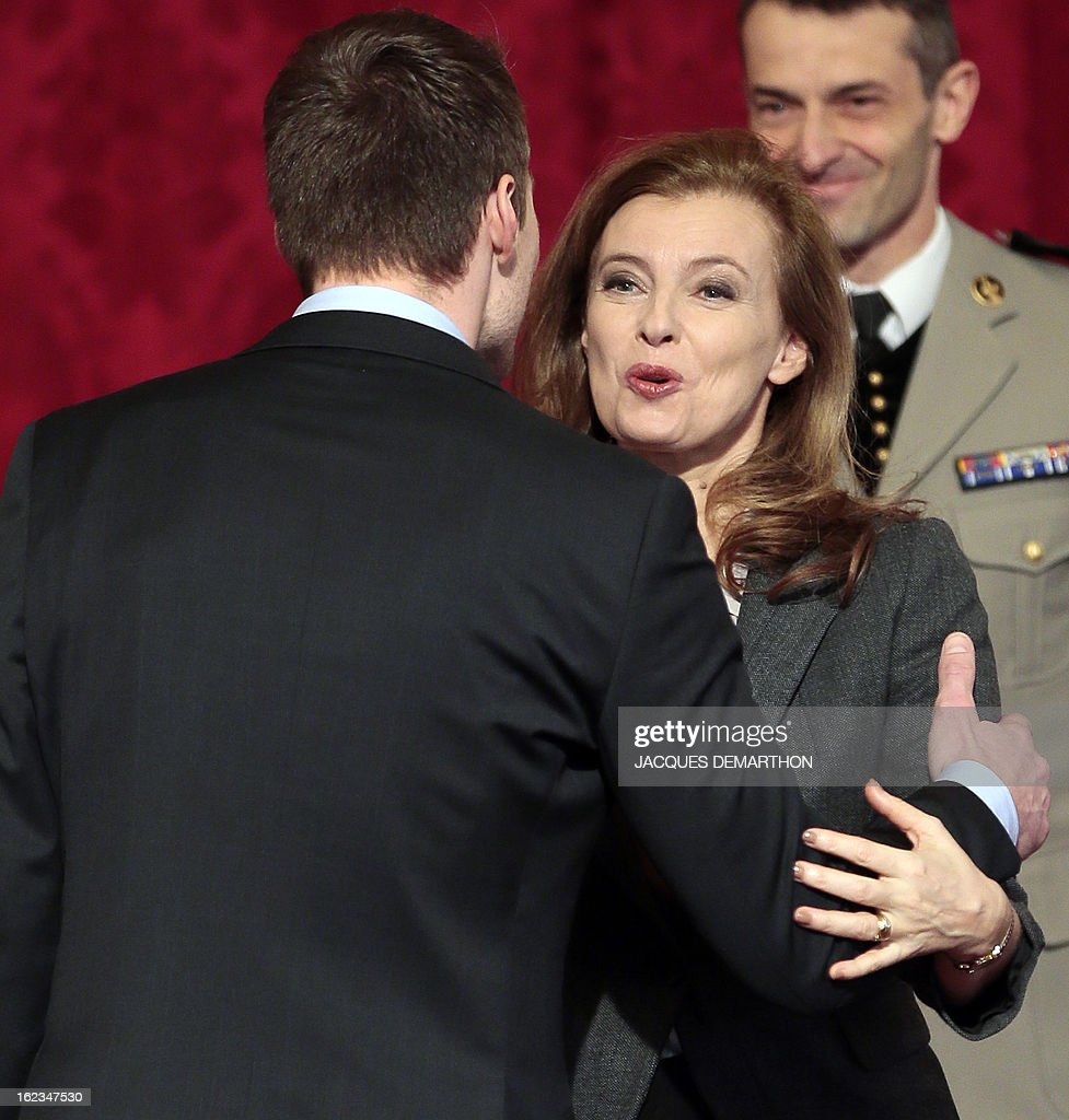 French swimmer and 2012 London Paralympic Games gold medalist Charles Rozoy is congratulated by French President's companion Valerie Trierweiler after receiving the Legion of Honor decoration during an awards ceremony at the Elysee Palace on February 22, 2013 in Paris. AFP PHOTO / POOL / JACQUES DEMARTHON