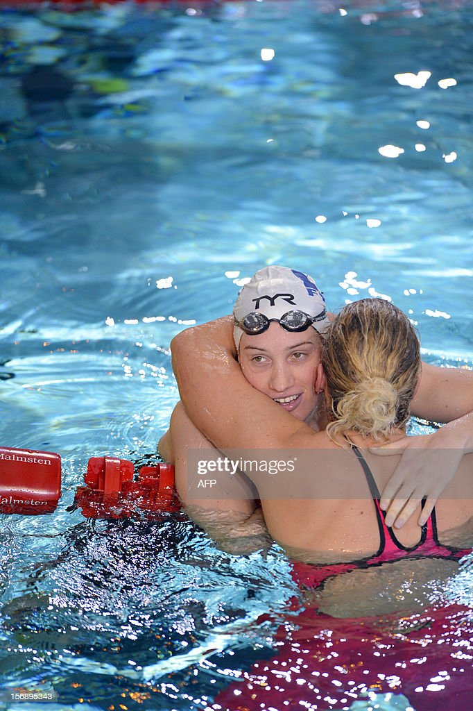 French swimmer Camille Muffat (L) is congratulated by Danish swimmer Lotte Friis after winning and setting a new world record in the short course women's 400m freestyle event at the European Swimming Championships on November 24, 2012, in Chartres. France's Olympic champion Camille Muffat won the 400m title at the European short course swimming championships in a new world record time of 3min 54.85sec.
