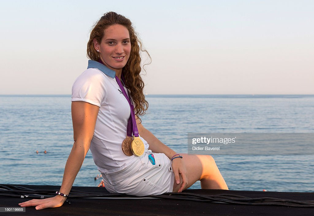 French Swimmer <a gi-track='captionPersonalityLinkClicked' href=/galleries/search?phrase=Camille+Muffat&family=editorial&specificpeople=596271 ng-click='$event.stopPropagation()'>Camille Muffat</a> poses in front of the Baie des Anges on August 10, 2012 in Nice, France.