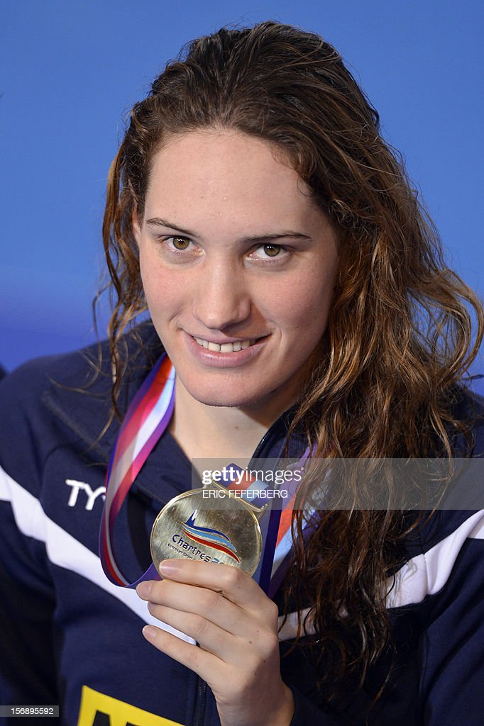 French swimmer Camille Muffat poses on the podium after winning the short course women's 400m freestyle event at the European Swimming Championships on November 24, 2012, in Chartres. Muffat set a new world record time of 3min 54.85sec.