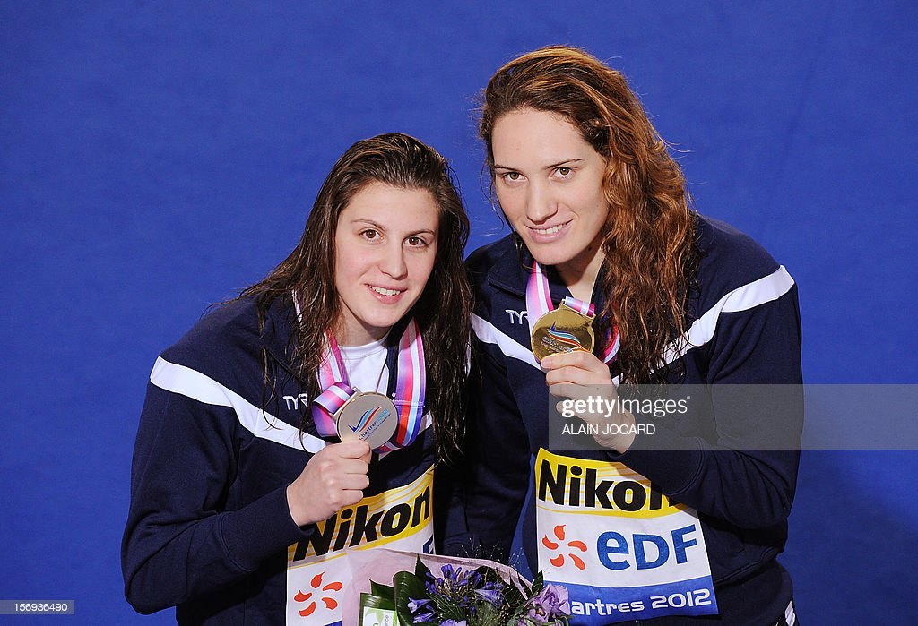 French swimmer Camille Muffat (R) poses with her gold medal next to second-placed Charlotte Bonnet after winning the women's 200 m freestyle final at the European short course swimming championships, on November 25, 2012, in Chartres.