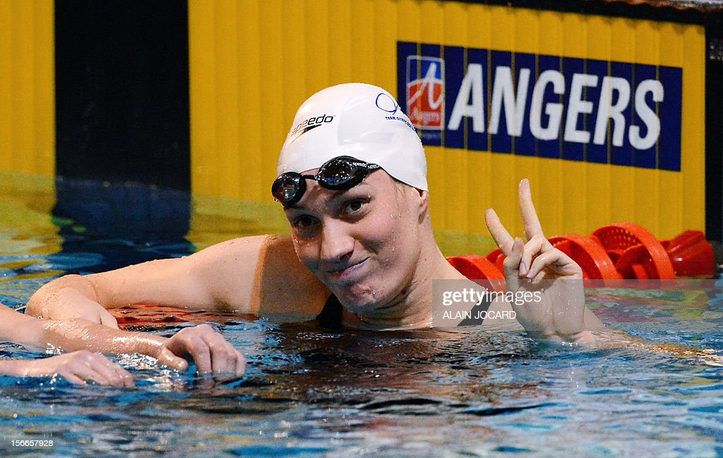 French swimmer Camille Muffat reacts after winning her 200m freestyle final as part of the swimming French championships on November 18, 2012, in Angers, western France.