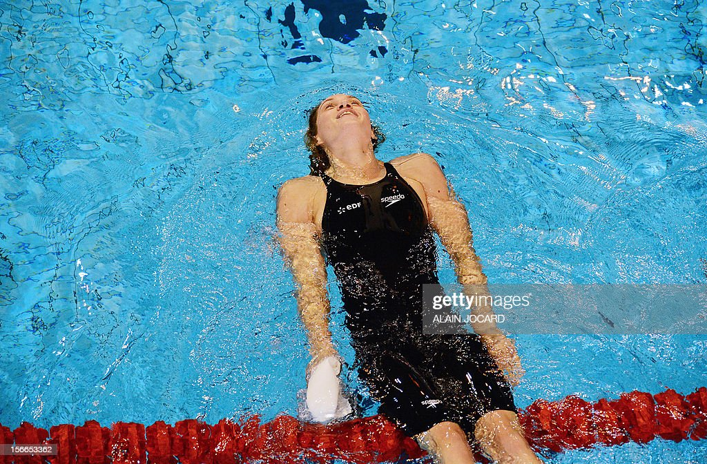 French swimmer Camille Muffat reacts after winning her short course women's 200m freestyle serie at the French championships, on November 18, 2012, in Angers, western France.
