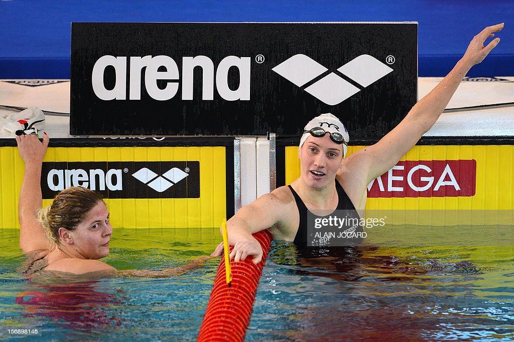 French swimmer Camille Muffat (R) reacts after winning the short course women's 400m freestyle event at the European Swimming Championships on November 24, 2012, in Chartres. France's Olympic champion Camille Muffat won the 400m title at the European short course swimming championships in a new world record time of 3min 54.85sec. AFP PHOTO / ALAIN JOCARD