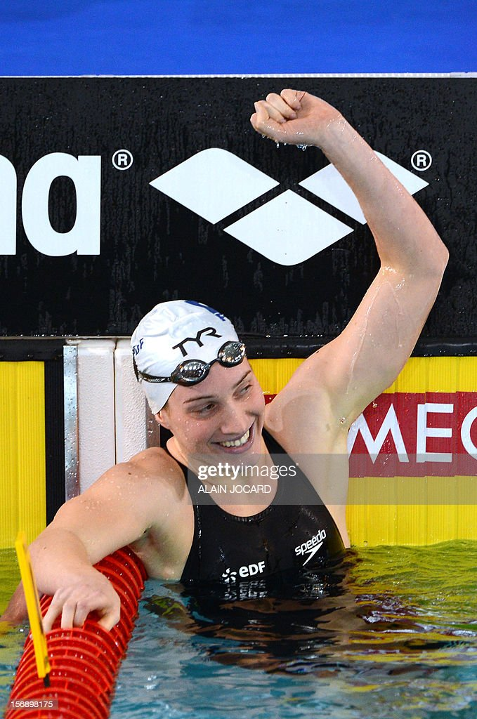 French swimmer Camille Muffat reacts after winning the short course women's 400m freestyle event at the European Swimming Championships on November 24, 2012, in Chartres. France's Olympic champion Camille Muffat won the 400m title at the European short course swimming championships in a new world record time of 3min 54.85sec.
