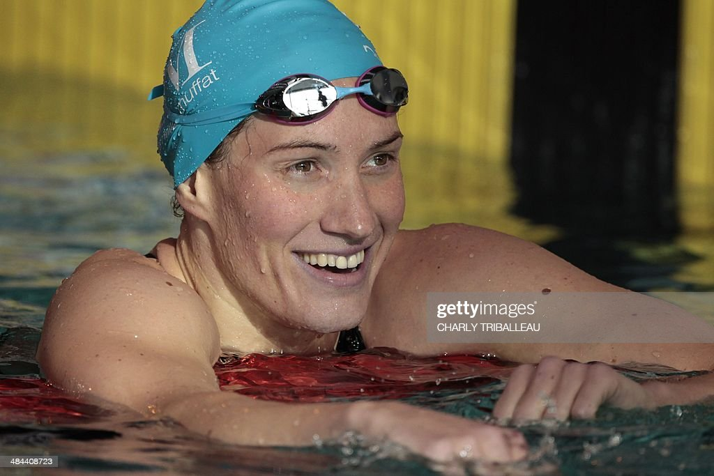 French swimmer Camille Muffat reacts after winning the women's 200m freestyle final heat of the French swimming championships in Chartres on April 12, 2014.