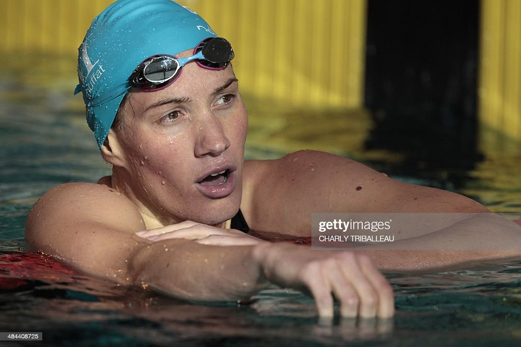 French swimmer <a gi-track='captionPersonalityLinkClicked' href=/galleries/search?phrase=Camille+Muffat&family=editorial&specificpeople=596271 ng-click='$event.stopPropagation()'>Camille Muffat</a> reacts after winning the women's 200m freestyle final heat of the French swimming championships in Chartres on April 12, 2014. AFP PHOTO/CHARLY TRIBALLEAU