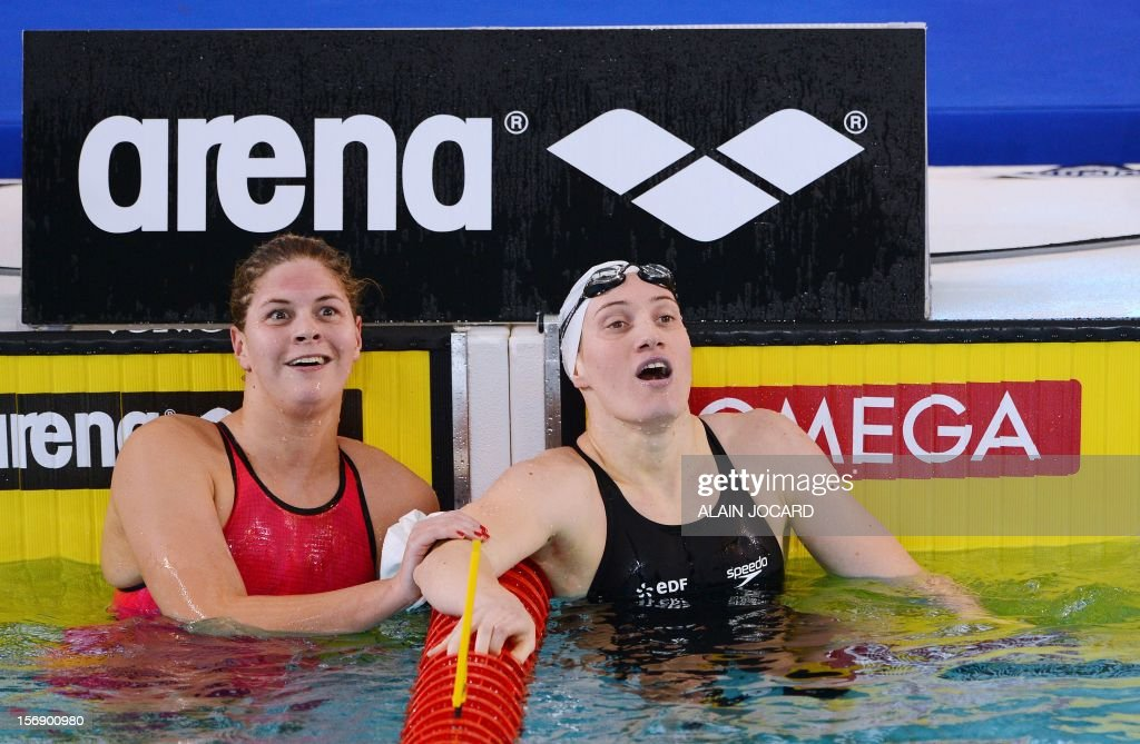 French swimmer Camille Muffat (R) reacts next to Danish Lotte Friis (L) after winning the short course women's 400m freestyle in 3:54.85 to break the world record on November 24, 2012 at the European Swimming Championships in Chartres. AFP PHOTO / ALAIN JOCARD