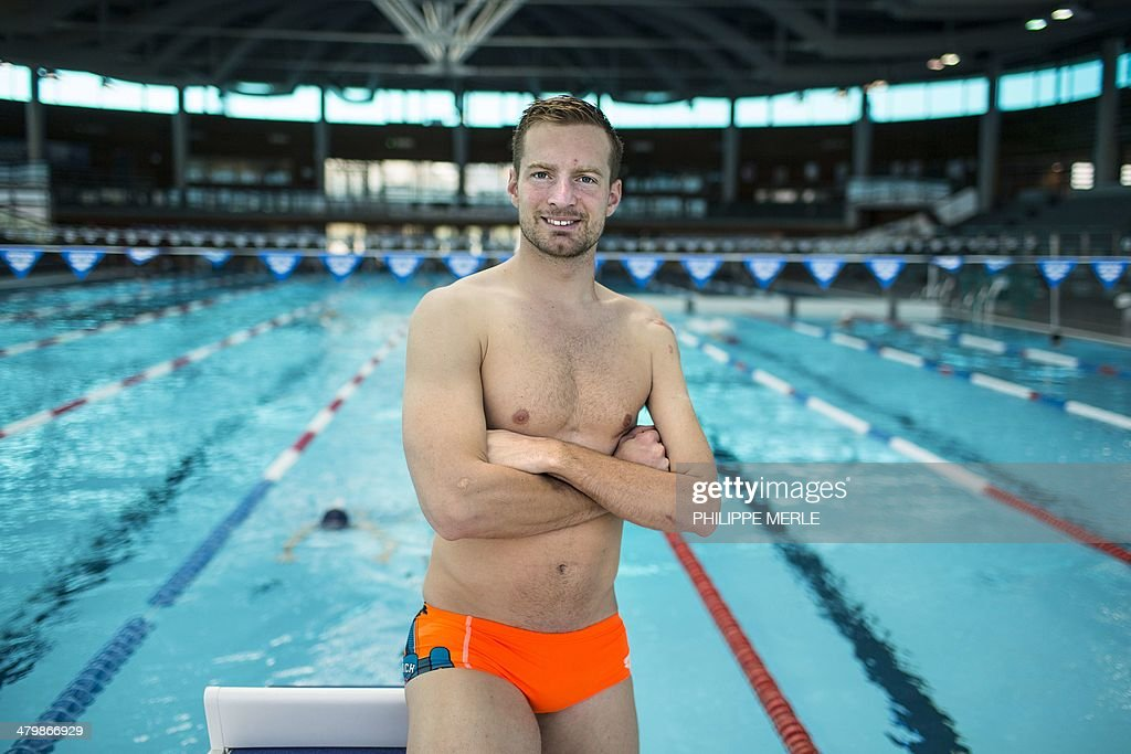 French swimmer Charles Rozoy, gold medalist at the 2012 London paralympics games, poses on March 14, 2014 at the swimming pool in Dijon. Valid sportsman until July 2008, Charles Rozoy was victim of a motorcycle accident, which cost him the use of his left arm. He is now fifth on the electoral list of Francois Rebsamen, French senator and outgoing Socialist Party (PS) mayor of Dijon candidate for his reelection in the March 2014 municipal elections, with the insurance to get a position at the city council in case of victory of the socialist list.