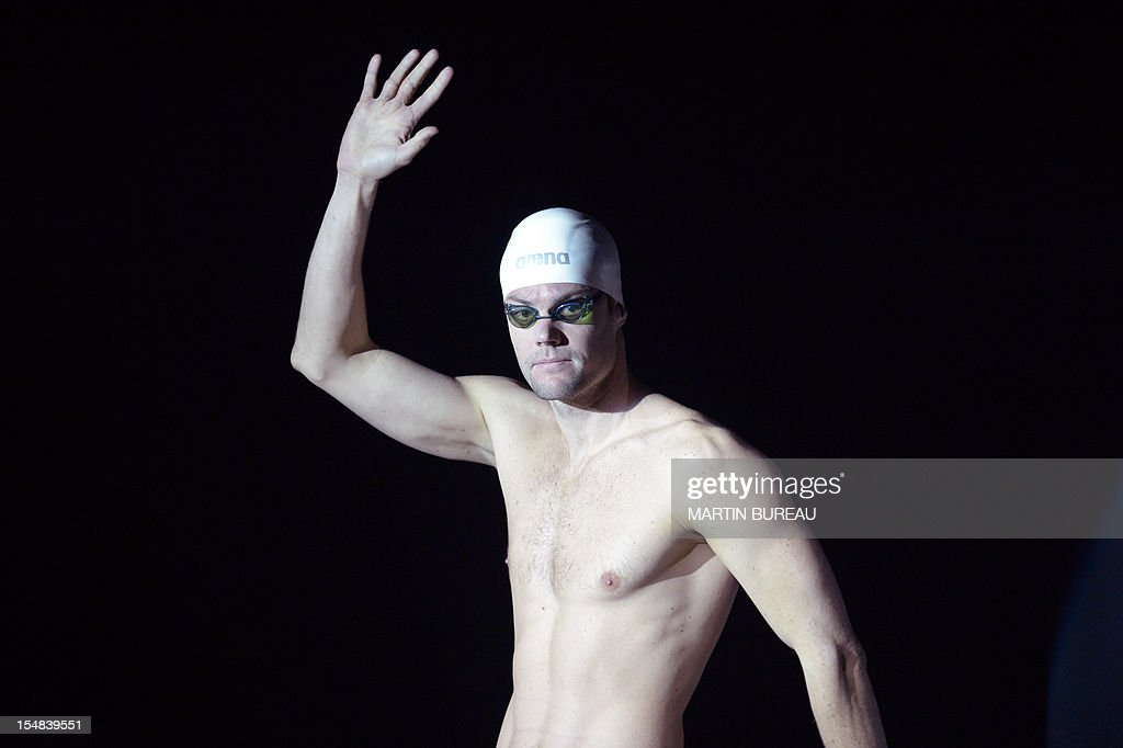 French swimmer Gregory Mallet acknowledges the audience as he attends the 2012 Autumn Swimming meeting on October 27, 2012 in Compiegne, north of Paris.