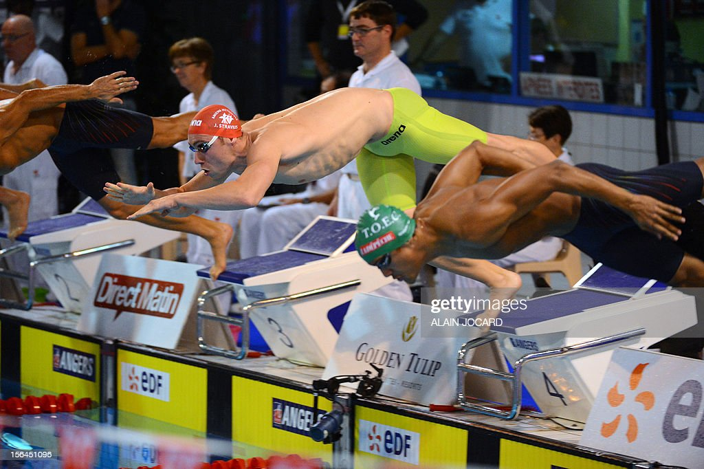 French swimmer Jeremy Stravius (C) dives as he competes in the men's short course 200m medley final at the French championships, on November 15, 2012 in Angers.