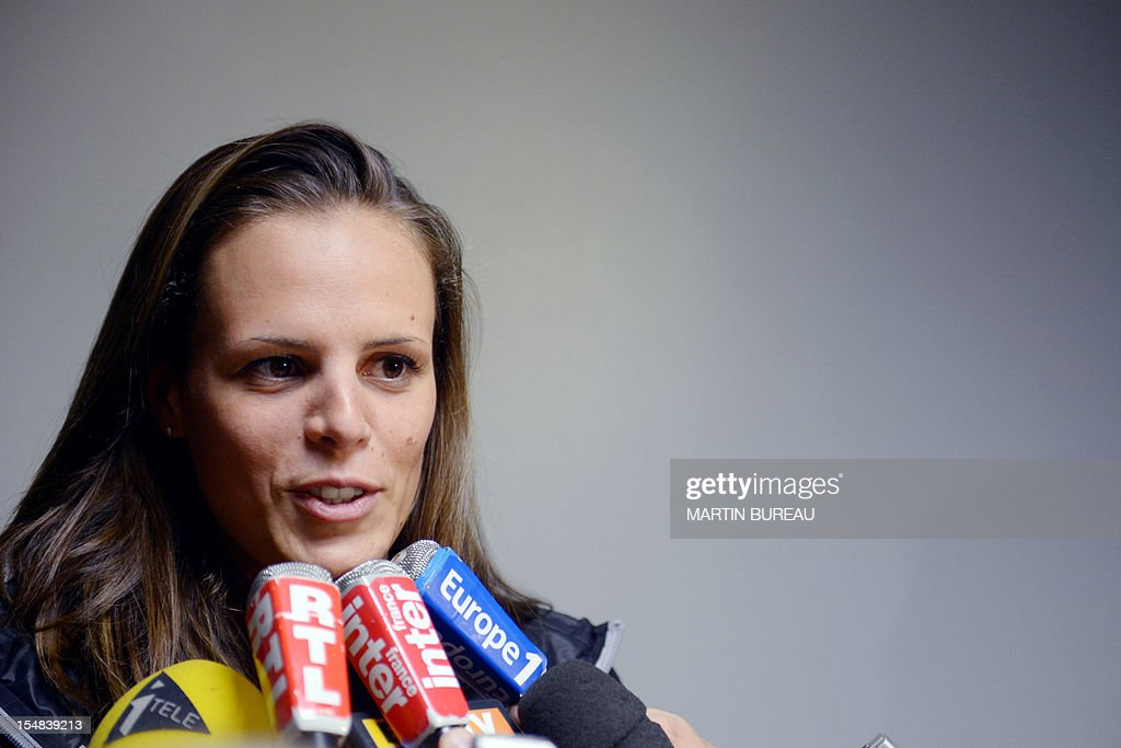 French swimmer Laure Manaudou answers journalists' questions on October 27, 2012 in Compiegne, during the 2012 Autumn Swimming meeting. French swimmer Laure Manaudou, the Olympic 400m freestyle champion at the 2004 Athens Games, will retire for a second time after next month's European Championships, the Le Courrier Picard newspaper reported. AFP PHOTO MARTIN BUREAU