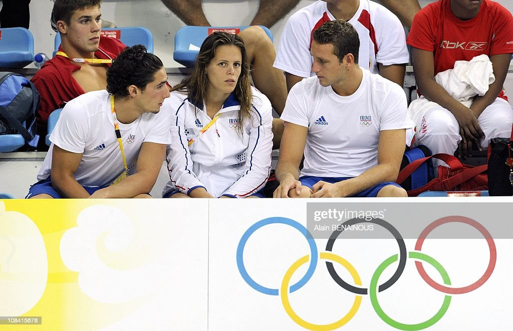 French swimmer Laure Manaudou boyfriend Benjamin Stasiulis and Boris Steimetzh during the qualifications at the Olympic National Aquatic Center in...