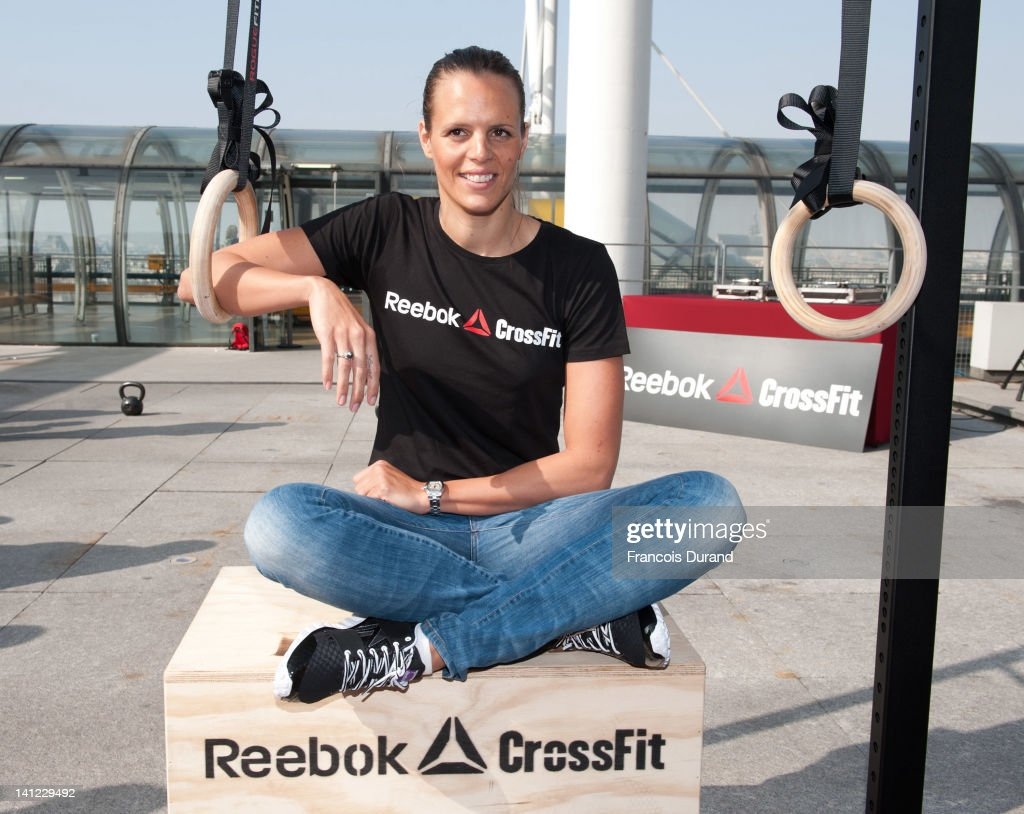 French swimmer <a gi-track='captionPersonalityLinkClicked' href=/galleries/search?phrase=Laure+Manaudou&family=editorial&specificpeople=596425 ng-click='$event.stopPropagation()'>Laure Manaudou</a> helps to launch Reebok's The Sport Of Fitness campaign on March 12, 2012 in Paris, France. The three-time Olympic medallist attended a public CrossFit workout, a revolutionary strength and conditioning programme, at the iconic Pompidou Centre. For more information visit www.reebok.com/fitness