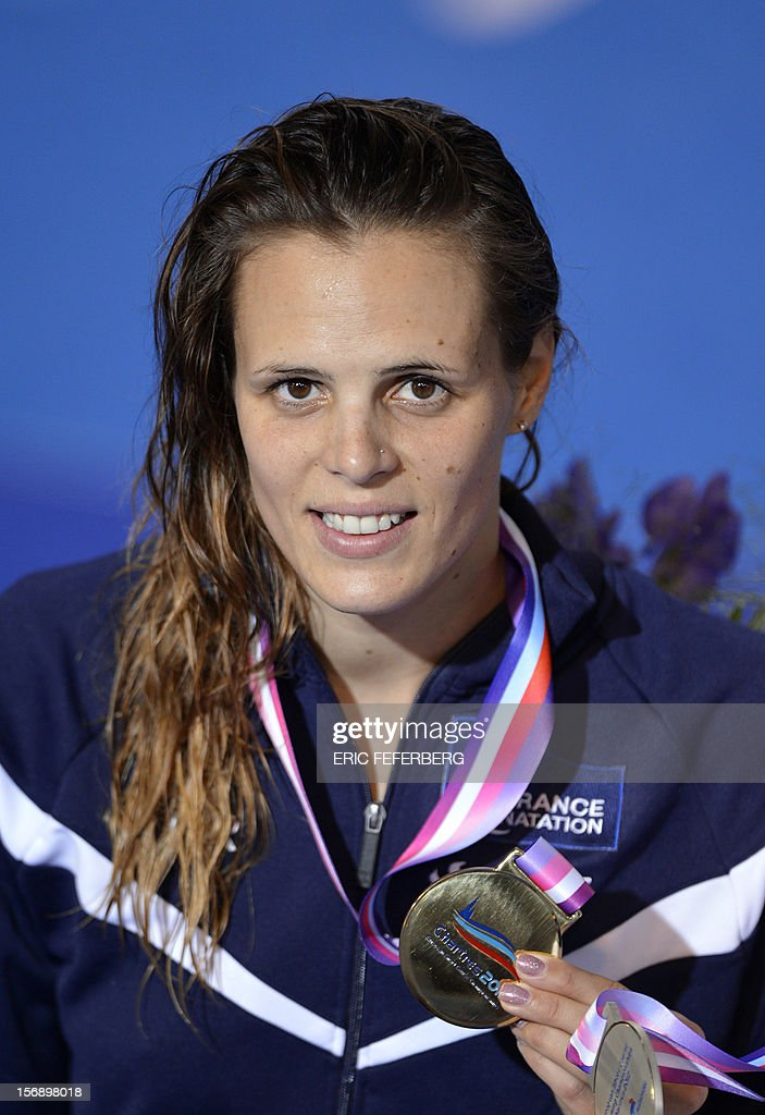 French swimmer Laure Manaudou poses with her gold medal on the podium after winning the short course women's 50m backstroke event at the European Swimming Championships on November 24, 2012, in Chartres.