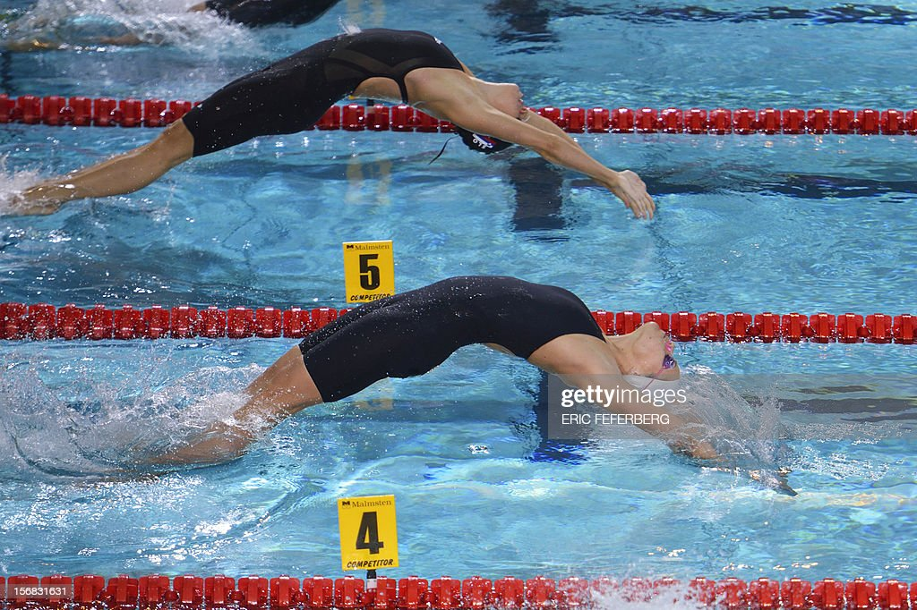 French swimmer Laure Manaudou (bottom) takes the start of the women's 200m backstroke semi-final at the European Short Course Swimming Championships on November 22, 2012, in Chartres.
