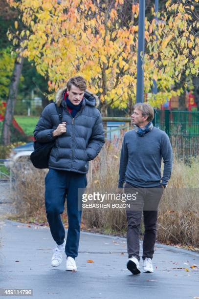 French swimmer Yannick Agnel and his new coach Lionel Horter arrives for a training session in Mulhouse eastern France on November 17 2014 Olympic...