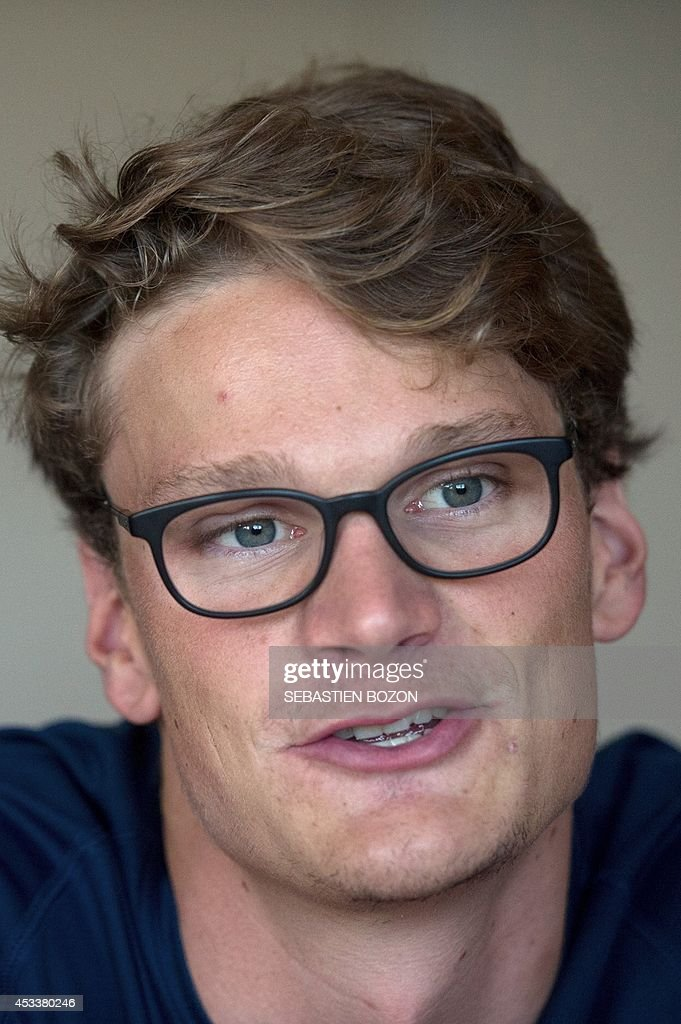 French swimmer <a gi-track='captionPersonalityLinkClicked' href=/galleries/search?phrase=Yannick+Agnel&family=editorial&specificpeople=6567514 ng-click='$event.stopPropagation()'>Yannick Agnel</a> answers journalists' questions during the French team training session in Mulhouse, eastern France, on August 9, 2014, prior to the European Swimming Championships. The Championships will run from August 13 to August 24, 2014 in Berlin, Germany.