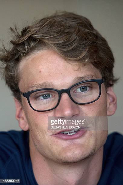 French swimmer Yannick Agnel answers journalists' questions during the French team training session in Mulhouse eastern France on August 9 prior to...