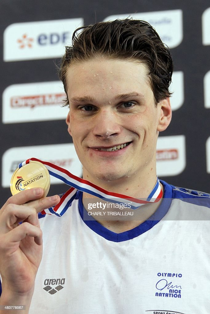 French swimmer <a gi-track='captionPersonalityLinkClicked' href=/galleries/search?phrase=Yannick+Agnel&family=editorial&specificpeople=6567514 ng-click='$event.stopPropagation()'>Yannick Agnel</a> celebrates with his gold medal on the winners podium of the men's 200m freestyle final on April 10, 2014 during the French swimming championships in Chartres.