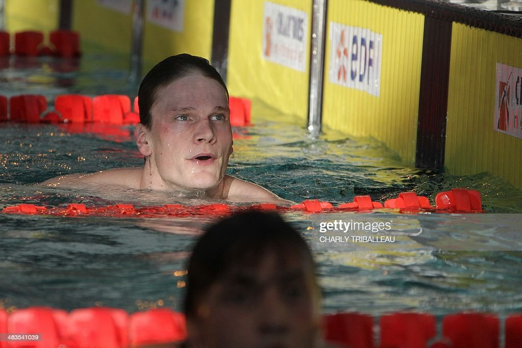 French swimmer Yannick Agnel (L) leaves the pool after competing and winning the men's 200m freestyle heat on April 9, 2014 during the French swimming championships in Chartres.