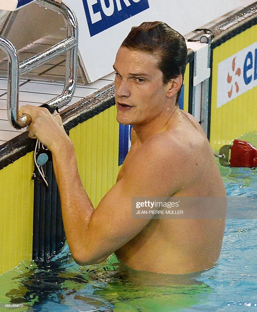 French swimmer <a gi-track='captionPersonalityLinkClicked' href=/galleries/search?phrase=Yannick+Agnel&family=editorial&specificpeople=6567514 ng-click='$event.stopPropagation()'>Yannick Agnel</a> reacts after competing in the series men's 100 m freestyle event at the French swimming championship in Limoges, on April 3, 2015. AFP PHOTO / JEAN PIERRE MULLER