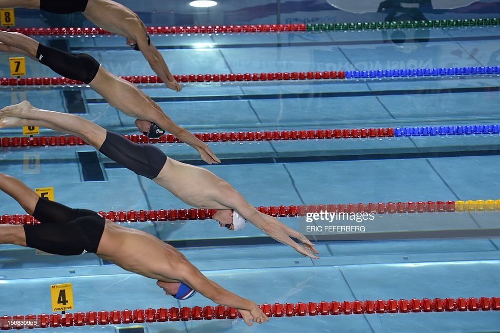 French swimmer Yannick Agnel (R) takes the start of the men's 400m frestyle final at the European Short Course Swimming Championships on November 22, 2012 in Chartres.