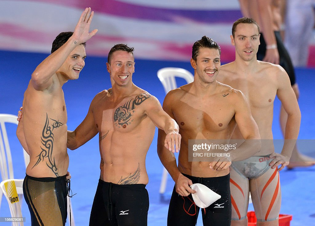 French swimmers (From L to R) Florent Manaudou, Frederick Bousquet, Giacomo Perez Dortona and Jeremy Stravius celebrate after winning the men's 4X50m medley relay at the European Swimming Championships on November 22, 2012, in Chartres.