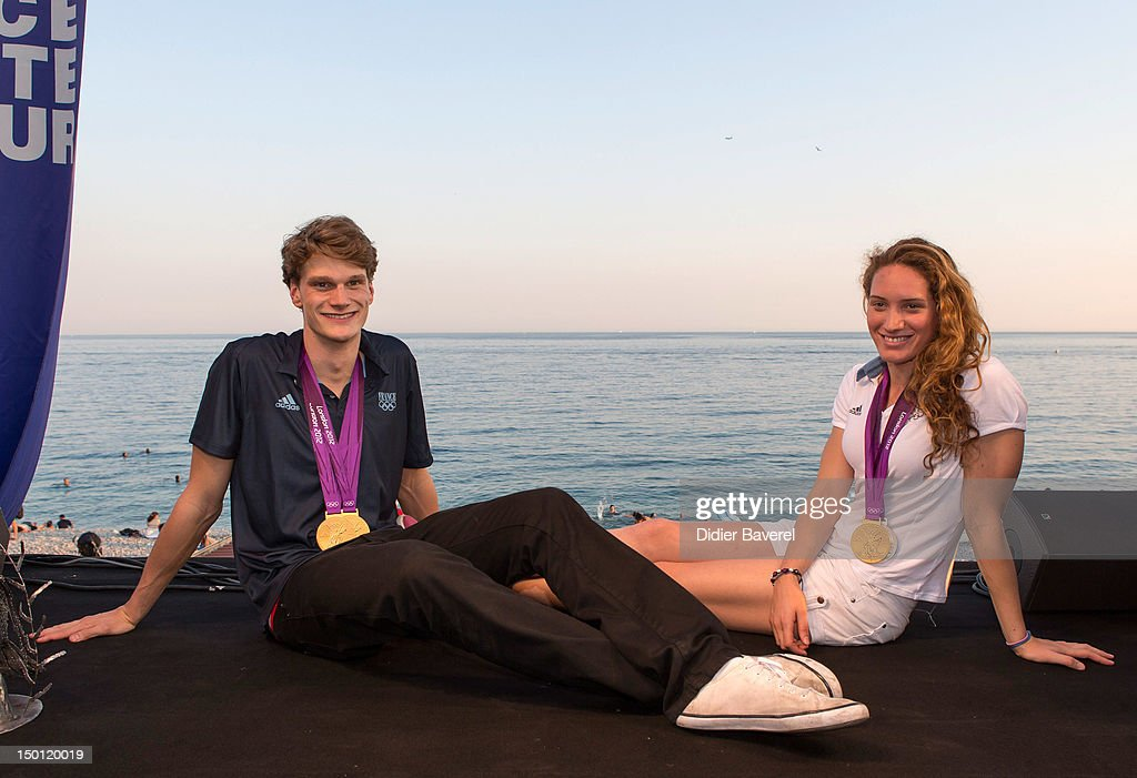 French Swimmers <a gi-track='captionPersonalityLinkClicked' href=/galleries/search?phrase=Yannick+Agnel&family=editorial&specificpeople=6567514 ng-click='$event.stopPropagation()'>Yannick Agnel</a> and <a gi-track='captionPersonalityLinkClicked' href=/galleries/search?phrase=Camille+Muffat&family=editorial&specificpeople=596271 ng-click='$event.stopPropagation()'>Camille Muffat</a> pose in front of the Baie des Anges on August 10, 2012 in Nice, France.
