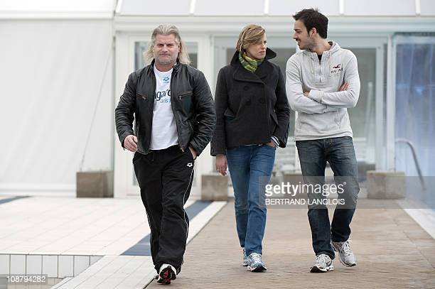 French swimming coach Philippe Lucas and Italian swimmers Federica Pellegrini and Luca Marin arrive at a press conference following their first...