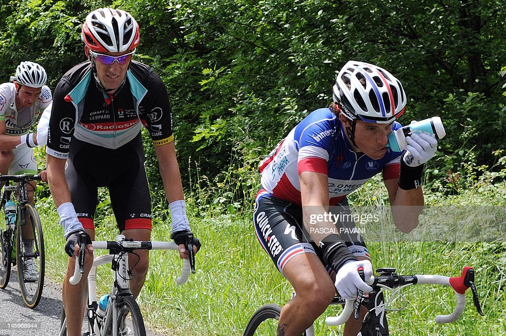 French Sylvain Chavanel (R) and Luxemburg Andy Schleck (L) rides during the fifth stage (186,5 km) of the 64rd edition of the Dauphine Criterium cycling race between Saint-Trivier-sur-Moignans and Rumilly, south-eastern France on June 8, 2012.