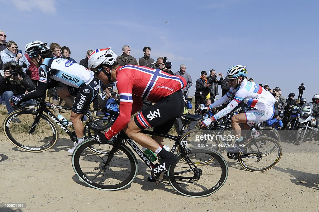 French Sylvain Chavanel of Omega Pharma - Quick Step, Norway's Edvald Boasson Hagen (C) of Sky Procycling and Slovenia's Borut Bozic of Astana Pro Team ride on a cobblestoned road during the 111th edition of the Paris-Roubaix one-day classic cycling race on April 7, 2013, between Compiegne and Roubaix, northern France.