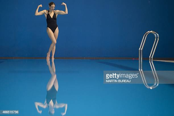 French synchronized swimming mixed duet member Virginie Dedieu poses on March 16 2015 at the Insep national Sport Institute in Vincennes outside...