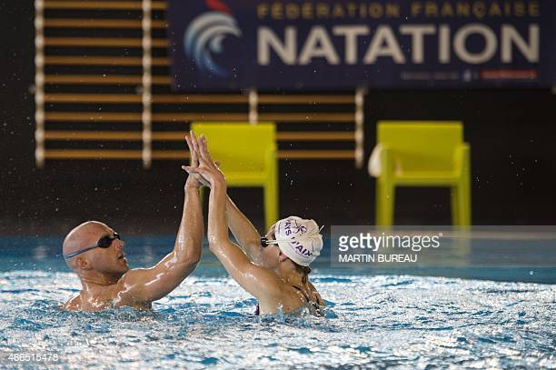French synchronized swimming mixed duet Virginie Dedieu and Benoit Beaufils practice on March 16 2015 at the Insep national Sport Institute in...