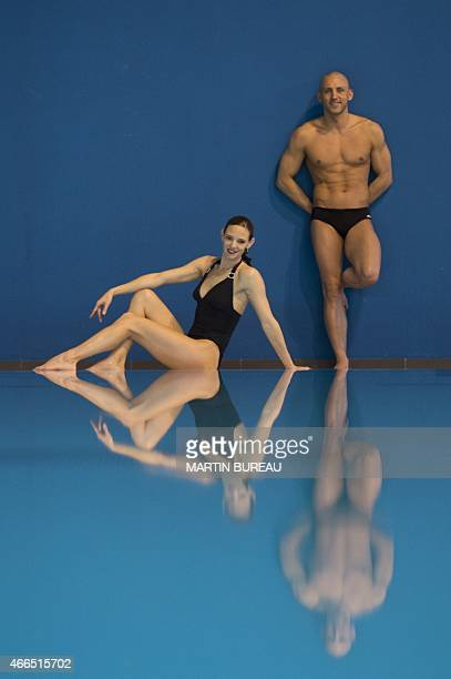 French synchronized swimming mixed duet Virginie Dedieu and Benoit Beaufils pose on March 16 2015 at the Insep national Sport Institute in Vincennes...