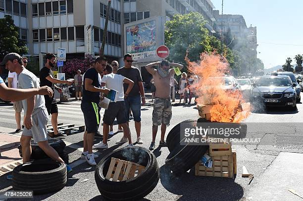 French Taxi drivers burn tires as they protest in the southern city of Marseille on June 25 2015 as they demonstrate against UberPOP a popular taxi...