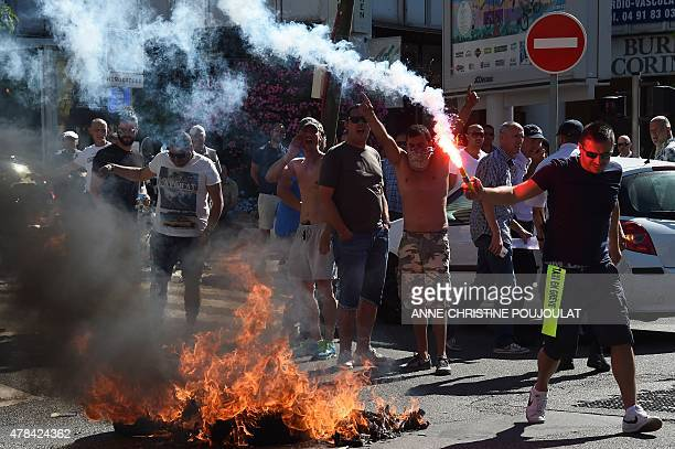 French Taxi drivers protest in the southern city of Marseille on June 25 2015 as they demonstrate against UberPOP a popular taxi app that is facing...