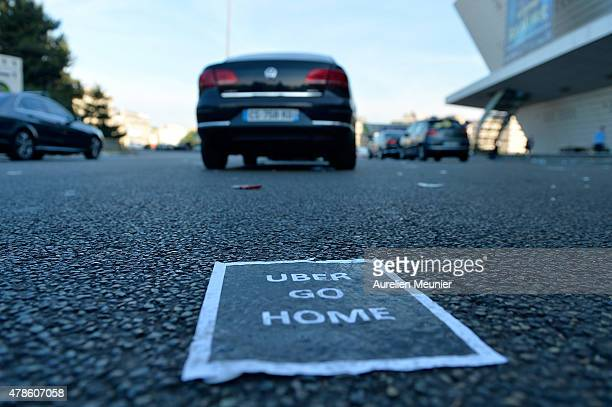 French taxis drivers on strike for the second day protest against the UberPOP application on June 26 2015 in Paris France The taxi drivers ask for...