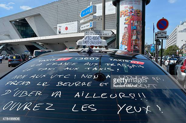 French taxis drivers on strike protest against the UberPOP app on June 25 2015 in Paris France The taxi drivers asked for the removal of the app and...