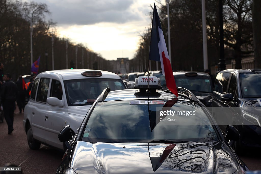 French taxis take part in a strike with London black cab drivers as they protest against Uber on February 10, 2016 in London, England. Drivers are claiming that Uber is not subjected to the same stringent regulation requirements as they are and that deregulation of the trade has compromised passenger safety.