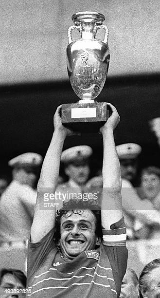 French team captain and midfielder Michel Platini is all smiles as he holds aloft the winner's cup after France defeated Spain 20 in the final of the...