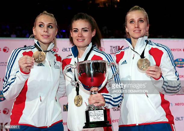 French team members Jessica Hugues Sonia Fuza and Clothilde Boulanger pose with their bronze medal during the podium ceremony for the women's team...
