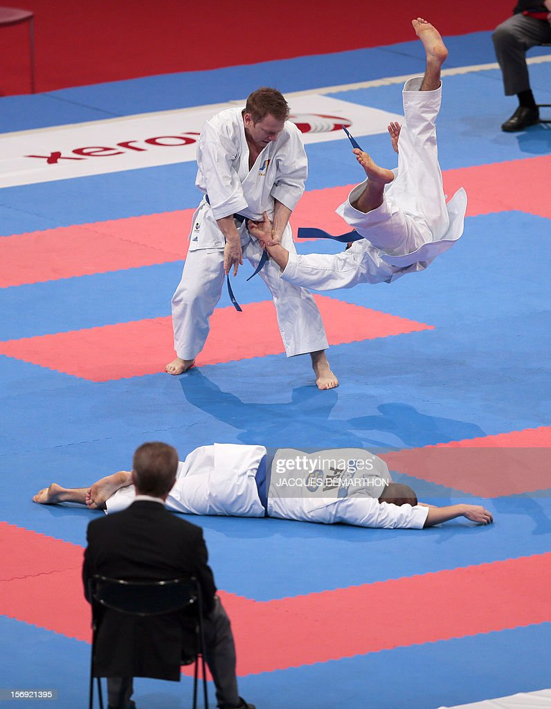 French team members practice on November 25, 2012 before the men's team kata semi-finals against Turkey of the Karate world championships at the POPB stadium in Paris.