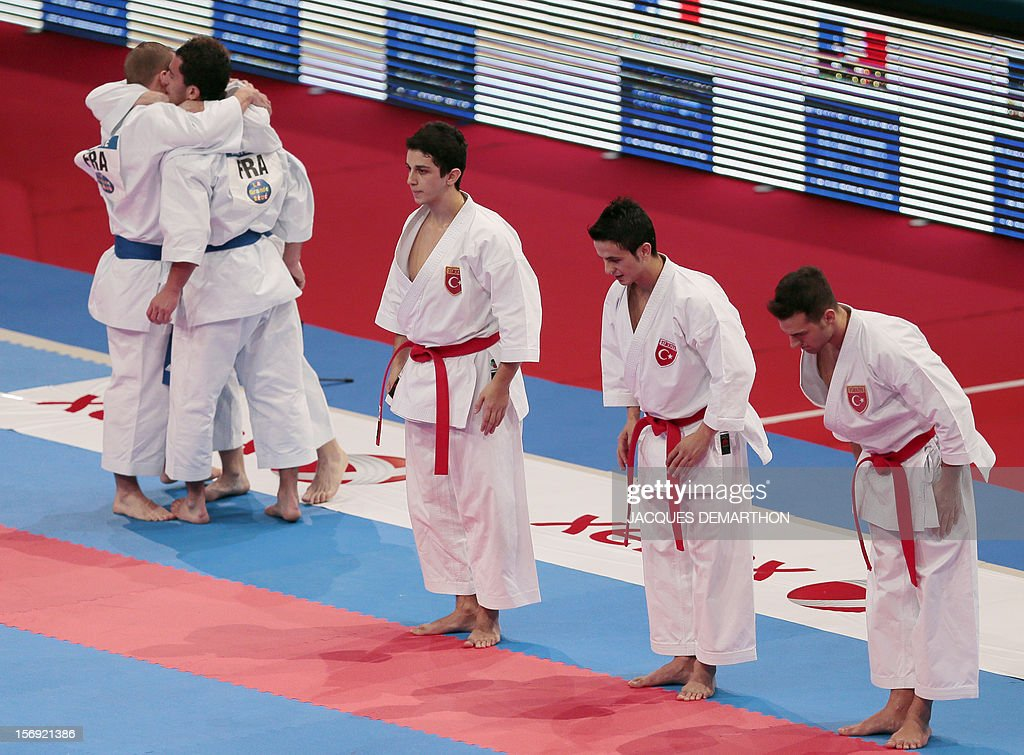 French team members prepare on November 25, 2012 before the men's team kata semi-finals against Turkey of the Karate world championships at the POPB stadium in Paris.