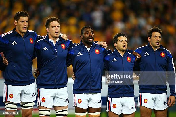 French team members sing their national anthem during the First International Test Match between the Australian Wallabies and France at Suncorp...