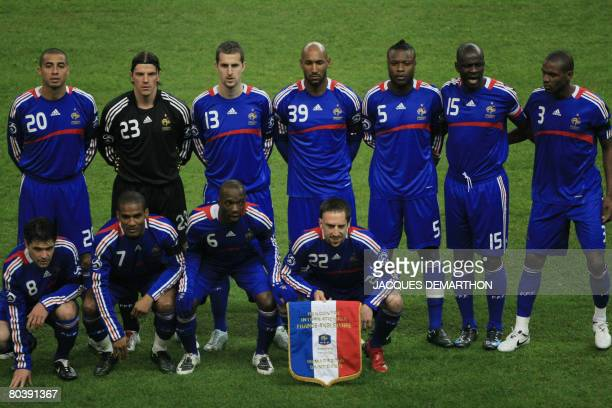 French team players wearing a black armband in homage of late French journalist Thierry Gilardi pose for a group picture before their friendly...