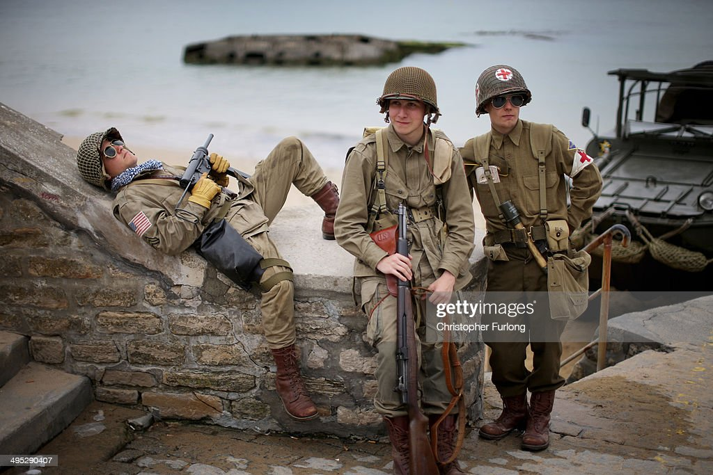 French teenagers who are part of a WWII reenactment group relax on the promenade of Arromanche next to 'Gold Beach'as preparations for the 70th Anniversary Of D-Day are finalised on June 2, 2014 in Arromanches-les-Bains, France. Friday 6th June is the 70th anniversary of the D-Day landings which saw 156,000 troops from the allied countries including the United Kingdom and the United States join forces to launch an audacious attack on the beaches of Normandy, these assaults are credited with the eventual defeat of Nazi Germany. A series of events commemorating the 70th anniversary are planned for the week with many heads of state travelling to the famous beaches to pay their respects to those who lost their lives.